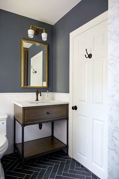 Classic Boys Bath With Herringbone Tile Floor And White Subway Tile Wall Charcoal Blue Walls And Bra Blue Bathroom Walls Dark Blue Bathrooms Painting Bathroom