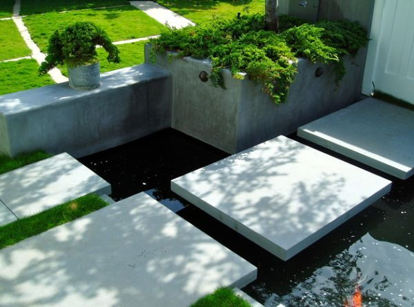 Koi pond in front yard with stylish floating steppers Front