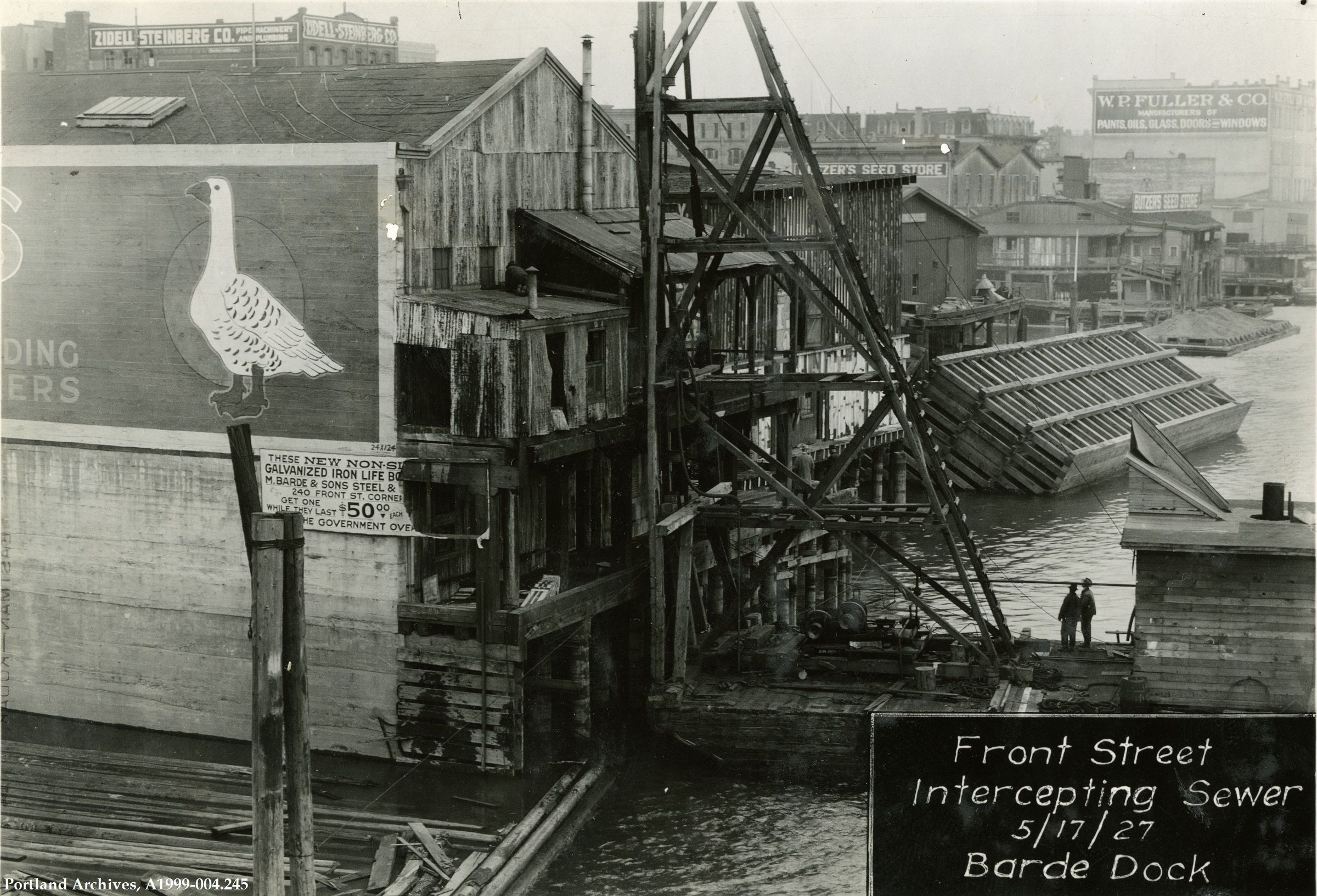 In this photograph of the Barde Dock, you see a crane used during the construction of the Front Avenue sewer (this project brought us the Harbor Wall). This image is looking north. Several business...