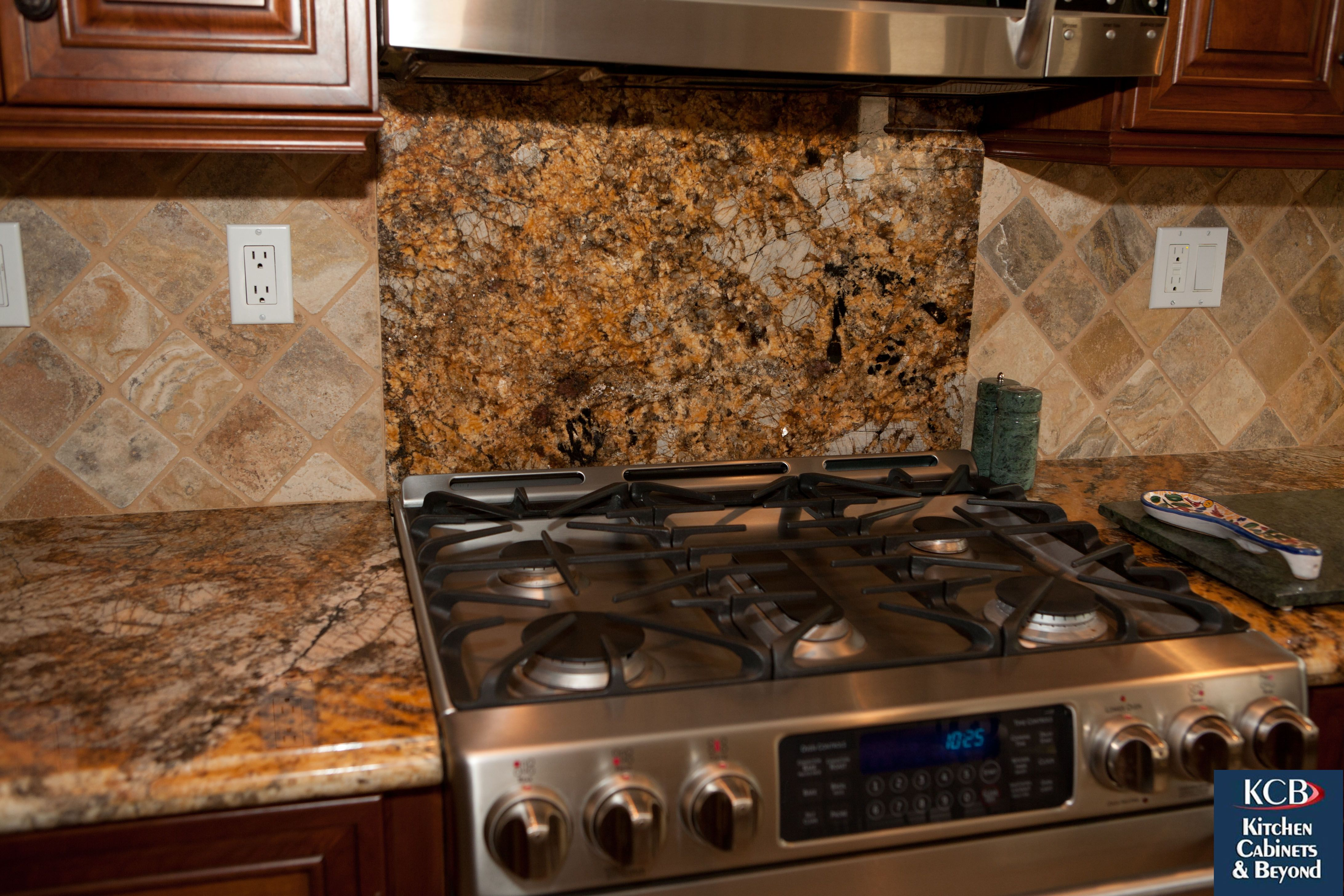 A Large Gas Stove With Beautiful Backsplash And Marble Countertops Are Perfect For Entertaining We Can Rem Beautiful Backsplash Kitchen Remodel Kitchen Design