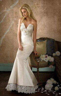 SB8569 - Creme silk duchess satin fluted bridal gown. Strapless pleated V- neckline with empire waist and flower detail. Ivory Alencon Lace peeks out  ... 2bcebd54a4ce