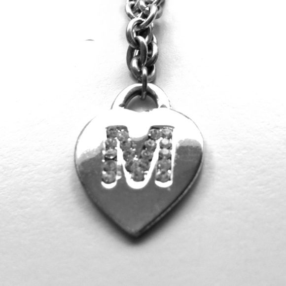 Silver M Initial Necklace I'm clearing out all the silver from my closet as I look much better in warm/gold tones. So here's another piece. Rhinestone M on a silver heart. 16 inch chain. Easy to connect without looking clasp. There is some wear on the finish on some areas of the chain. No PayPal. Justice Jewelry Necklaces