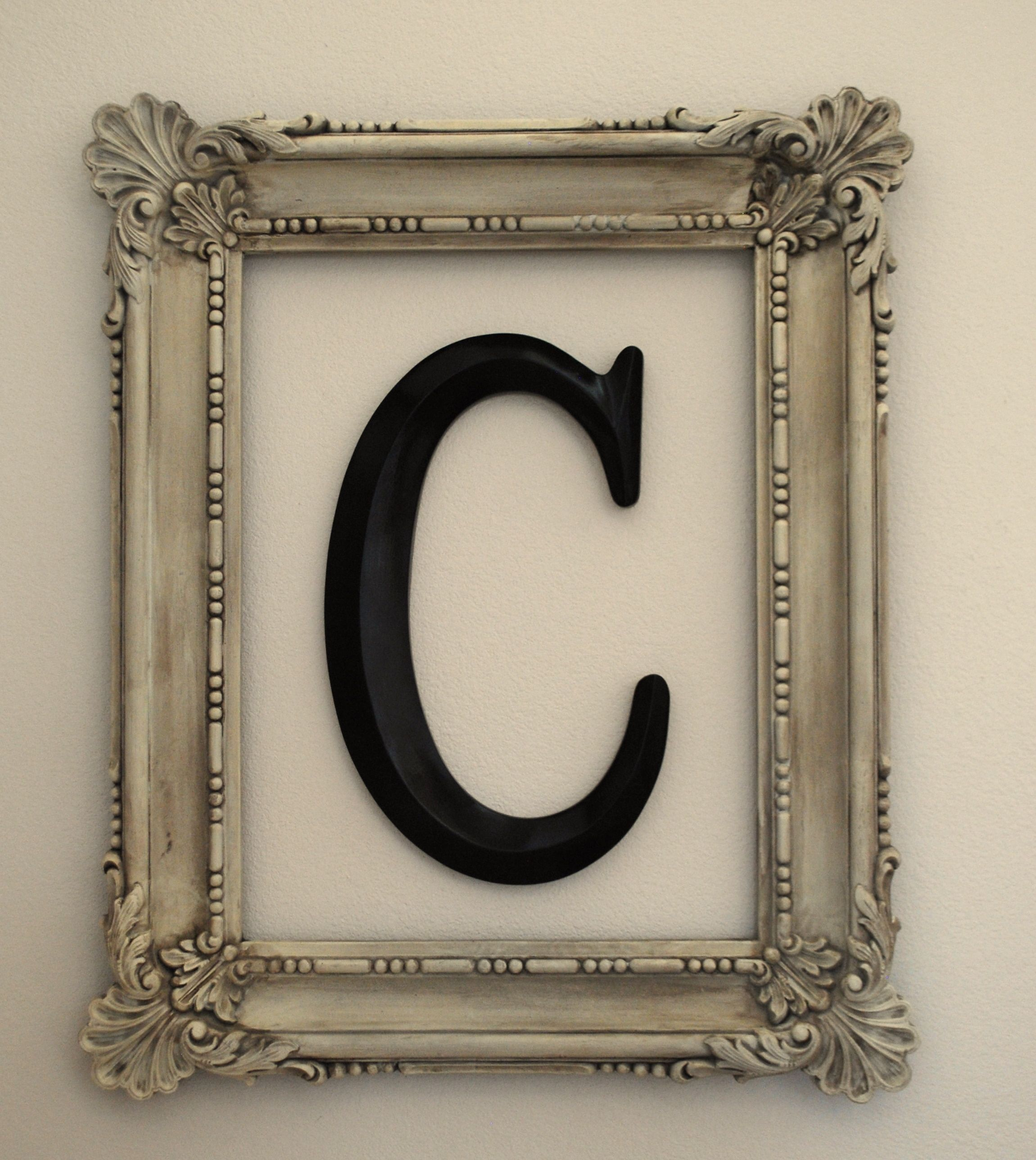 Another DIY decorating project-- making a framed monogram from thrift store items. Easy home decor that looks fabulous!