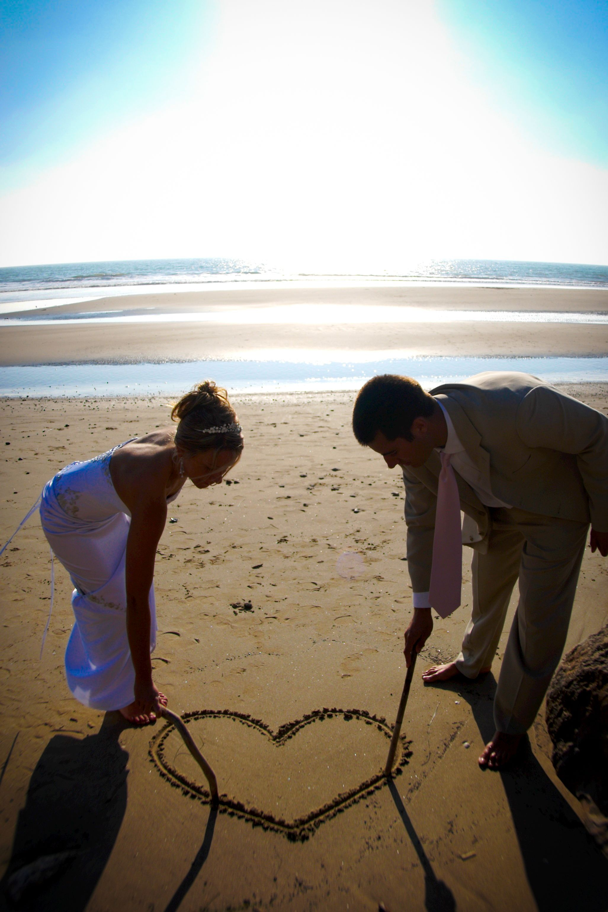 Beach wedding idea  This couple hearts the sand at Sundial Beach Resort beachwedding