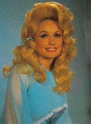 Dolly Parton. I always thought Dolly looked like Ellie Mae Clampett but when I looked at pics of Donna Douglas, they do not favor. Must be the hair!