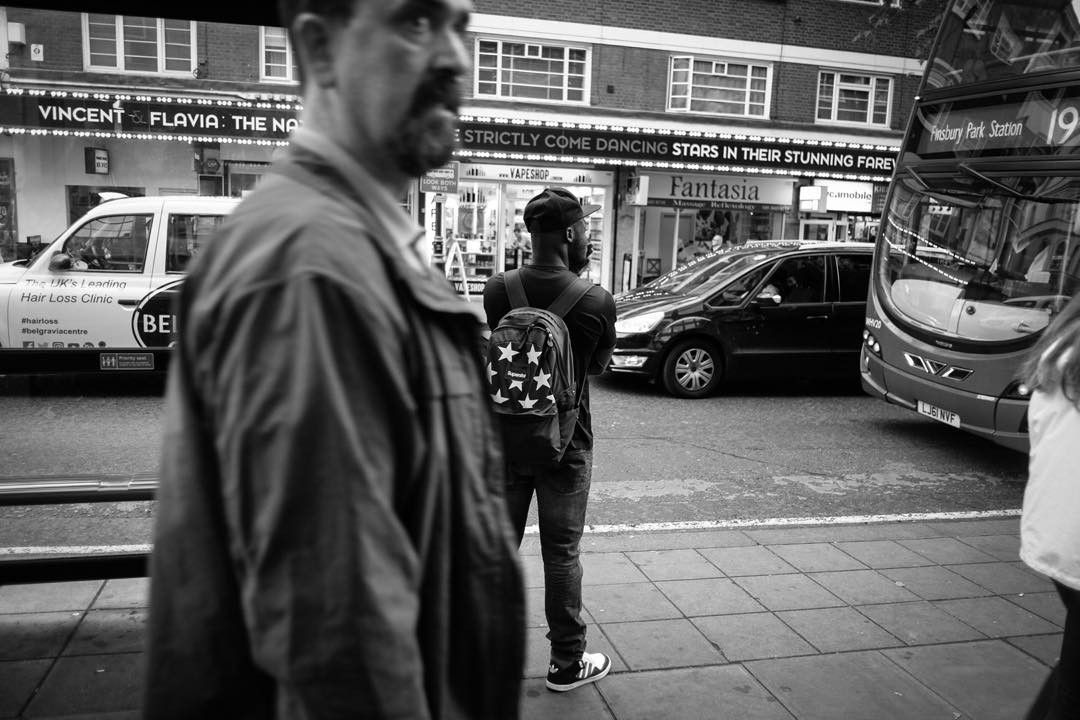 """Stars - London 2017- originally focused on the guy with stars on his backpack & the """"strictly come dancing"""" sign then this completely contrasting character steels the show as he strolls into frame giving me that tension that seems to hold it together...Oh....& the look on his face...priceless. #onedailyfoto #streetphotography #streetportraits #storytelling #people #london #black&whitephotography #expression #photobomb www.onedailyfoto.org Sx"""