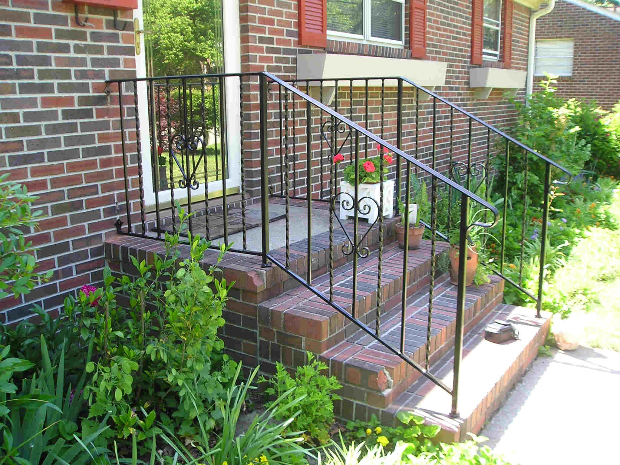 House front steps wrought iron porch railings stair for Exterior railings