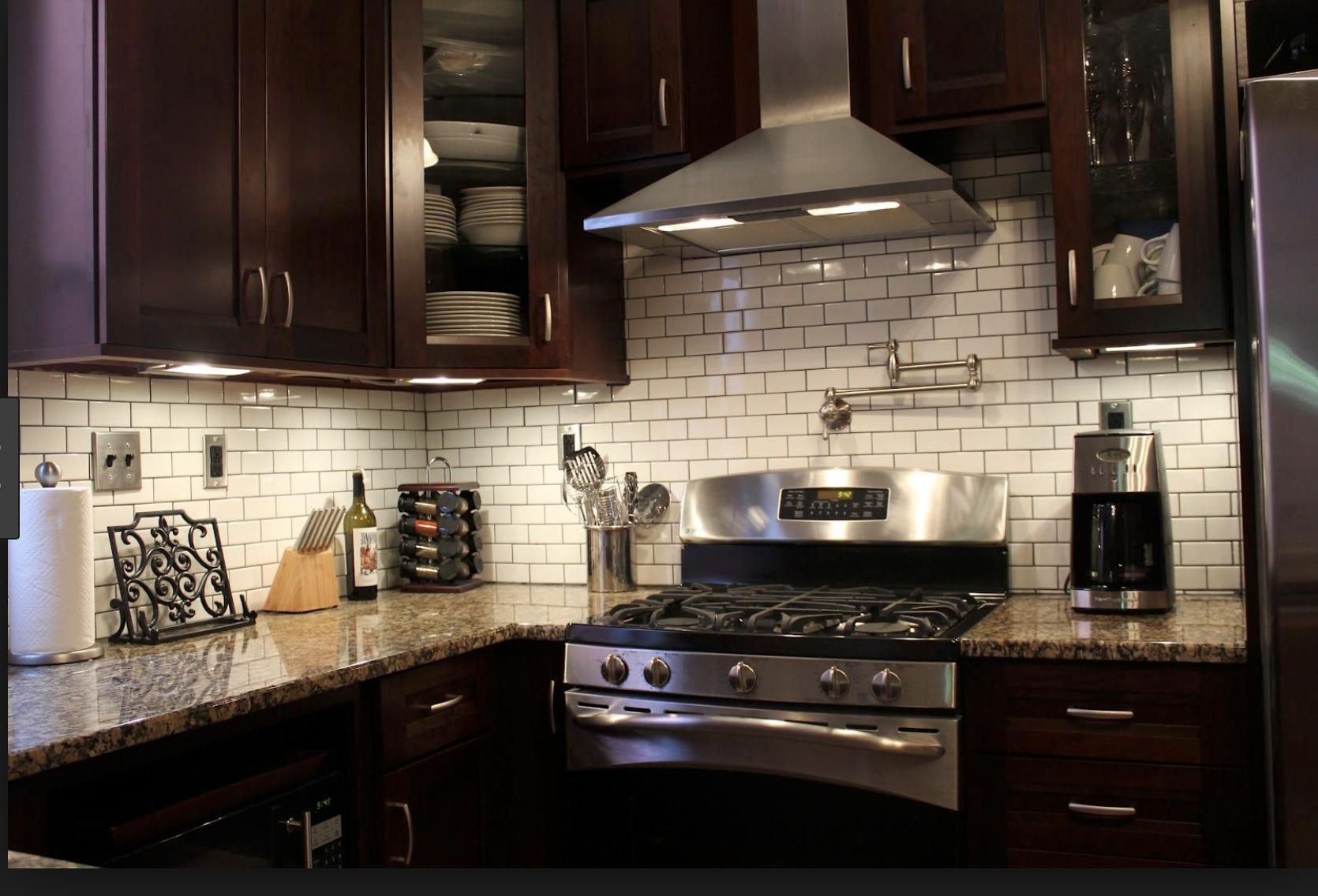 white tile backsplash, mahogany brown granite