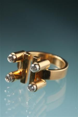 Ring Designed by Sigurd Persson, Sweden. 1960's. 18 ct gold and four diamonds.