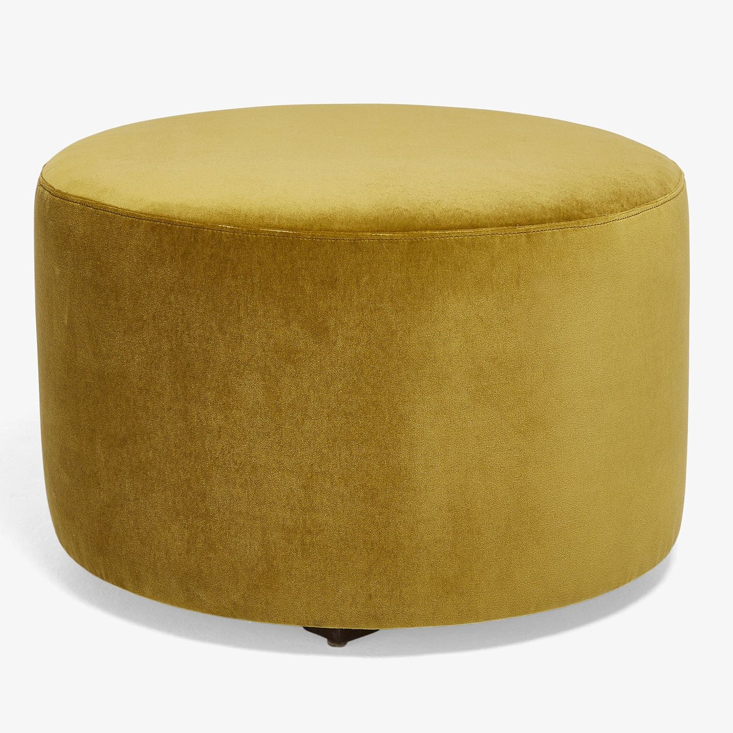 The Highline Mustard Round Ottoman Pairs A Crisp Linear Form With