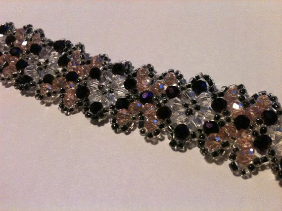 Purple/Pink/Black seed beadweaving bracelet.  check out my Etsy page! :-)