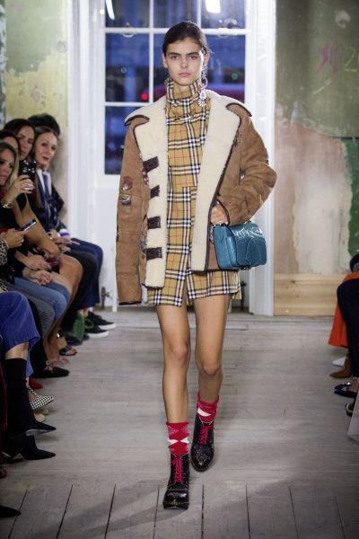 a1cf89dc155 The Burberry check trench and baseball cap is back. Fashion Week
