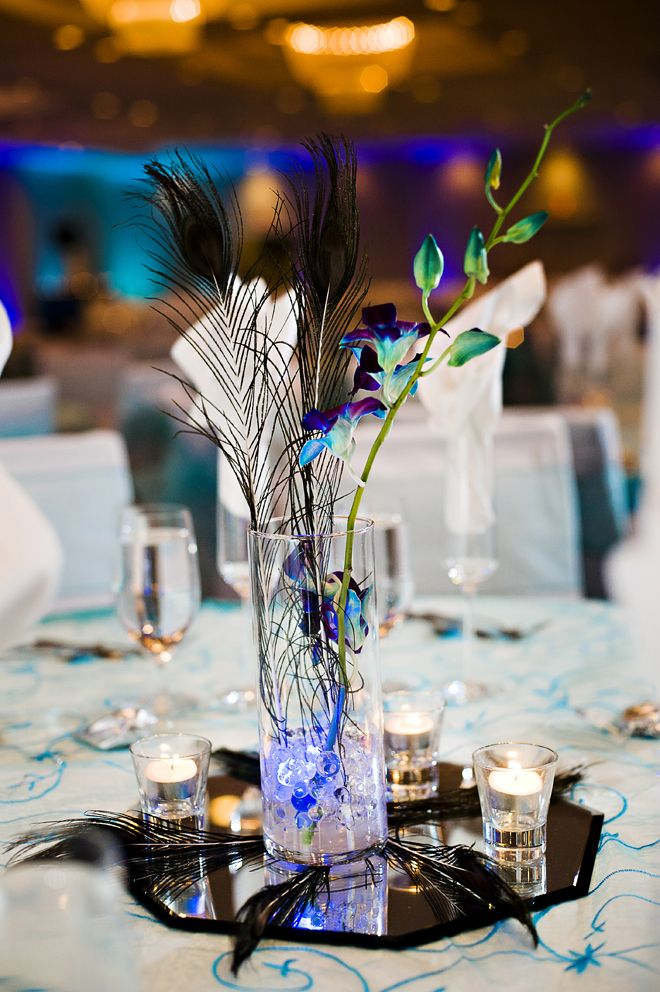 Minimalist diy centerpiece feathers and piece of