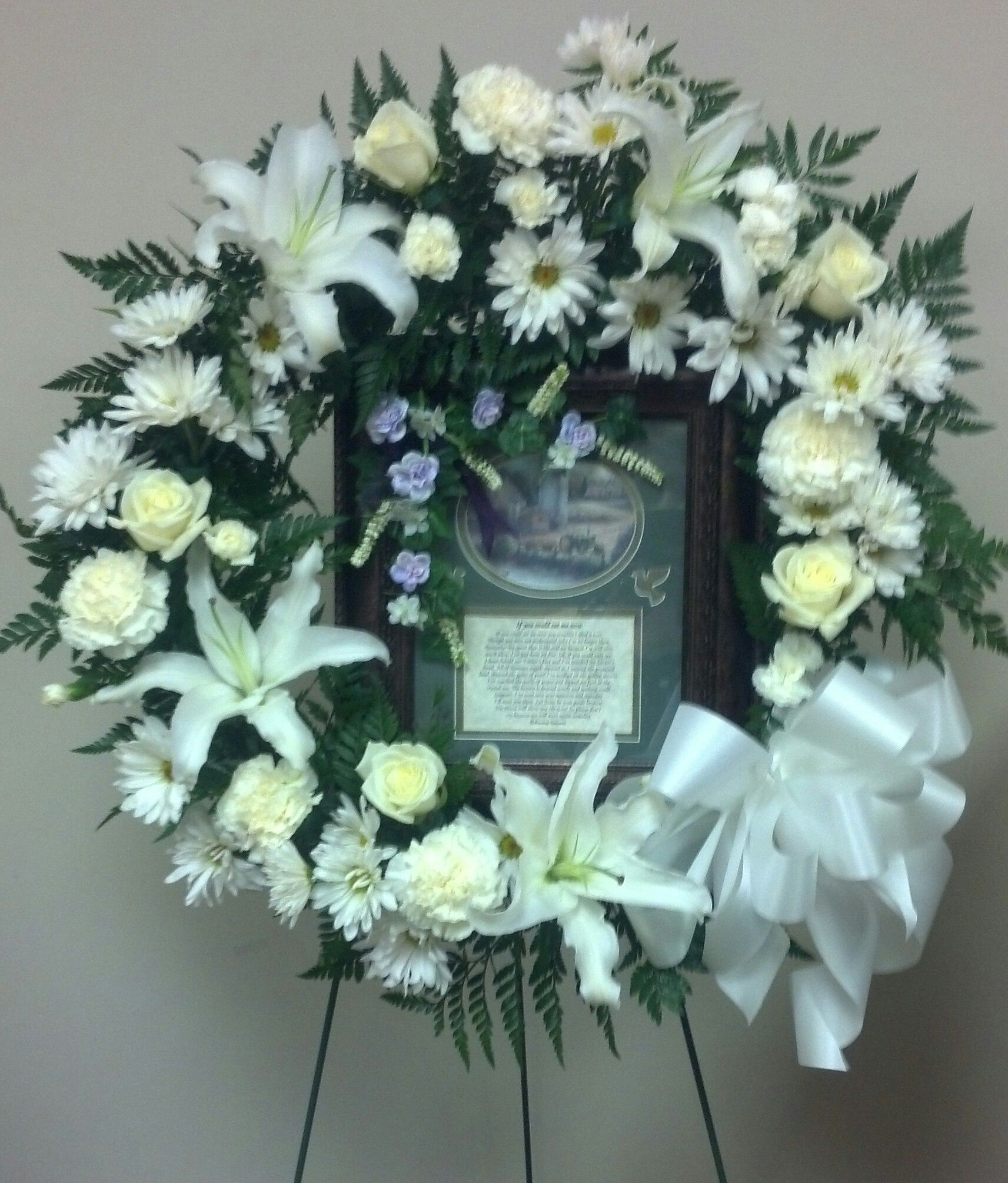 White Sympathy Wreath White Siberian Lily Daisy White Rose And White Carnations Funeral Arrangements White Carnation White Roses