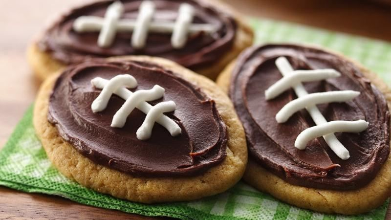 Score a touchdown at the dessert table with festive football-themed cookies from Betty Crocker. Ingredients: 1 pouch Betty Crocker Peanut Butter Cookie Mix Oil, water and egg called for on c...