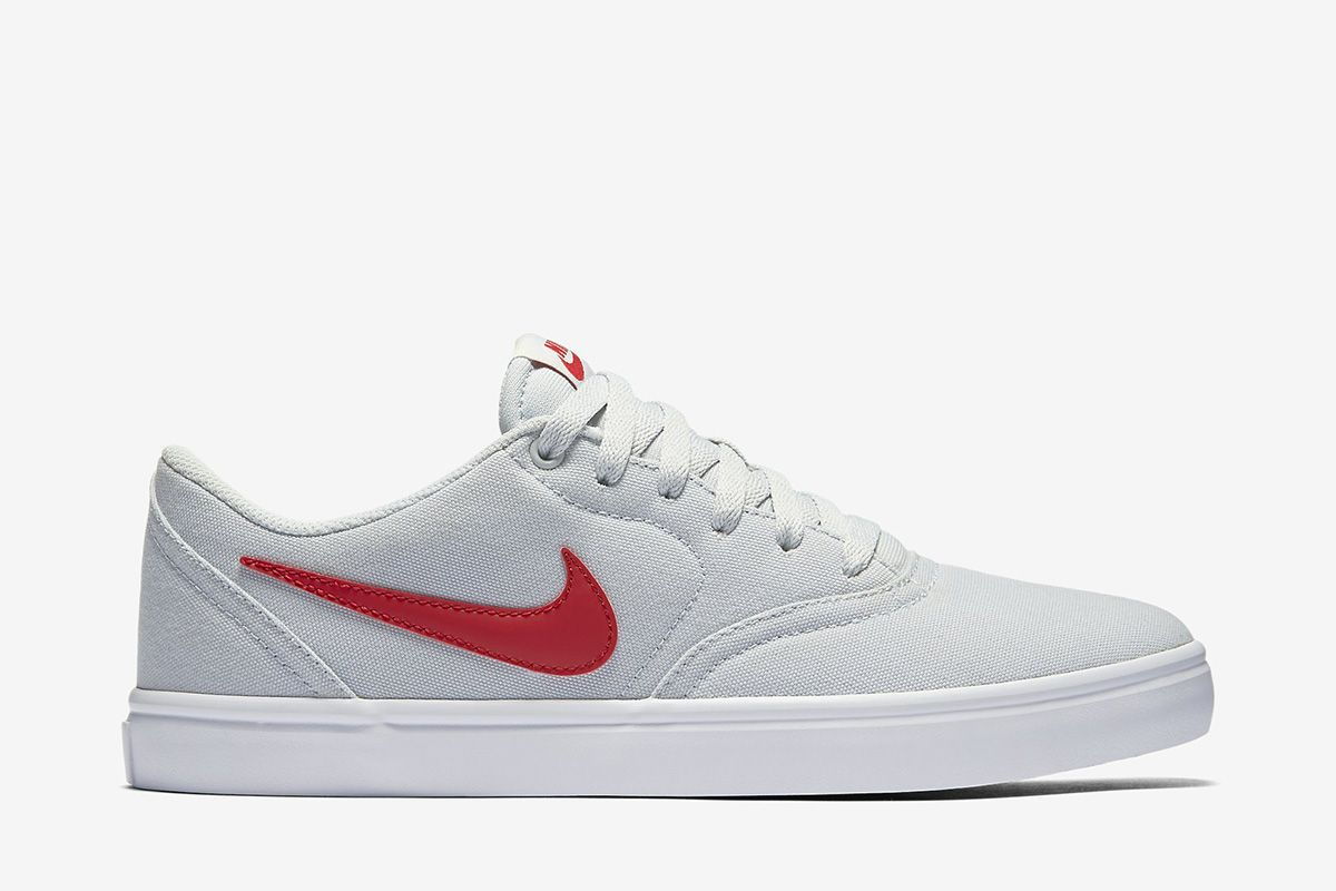 white nike with red check