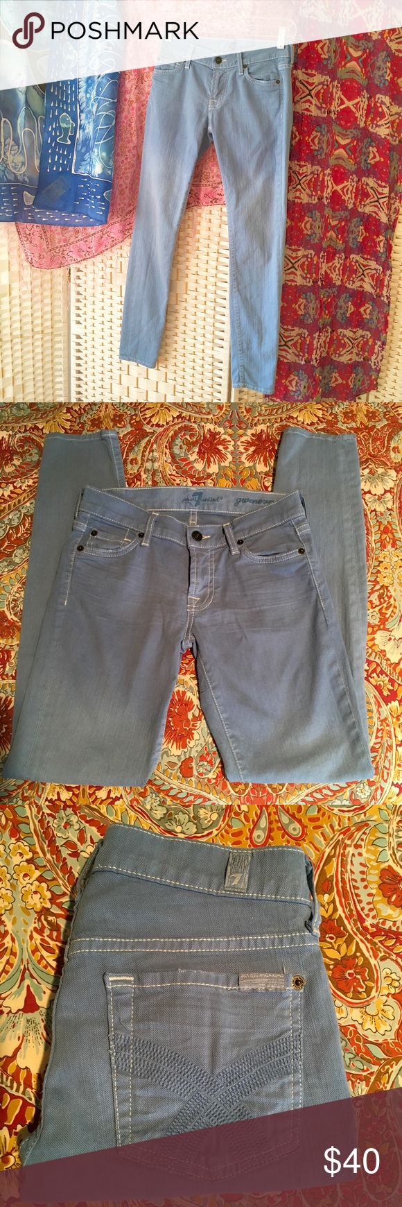 """7 For All Mankind Gwenevere Skinny Jean Skinny stretch Jean in Sky Blue. Cotton/ 2% spandex.  Contrast white stitching. 5 Pocket, stitched logo on back pockets. Very light gradation of fading below thigh. Inseam 28"""". Length 35.5"""". Rise 7"""". Ankle opening 10 1/4"""". Flat lay waist measurement 13"""" across. EUC. 7 For All Mankind Jeans Skinny"""
