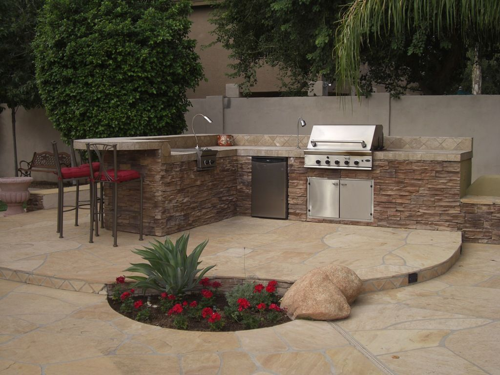 This pre fabricated island is a full outdoor kitchen for Pre built outdoor kitchen islands