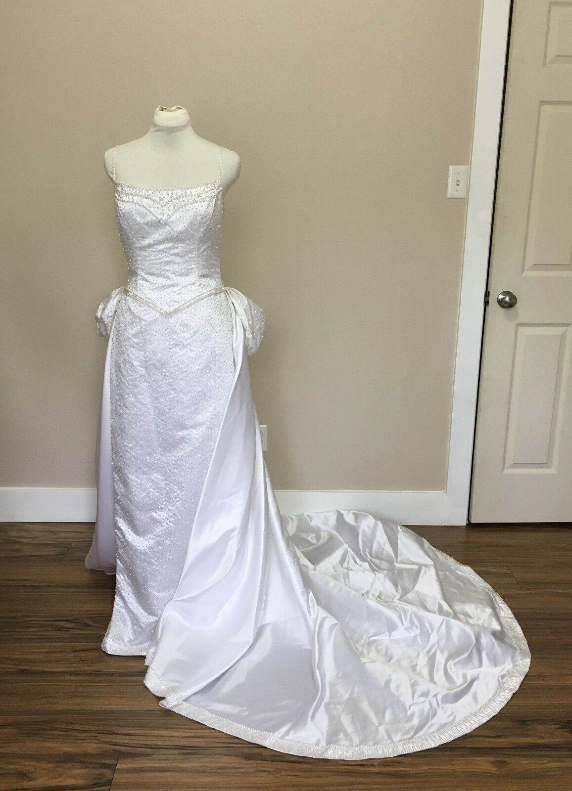 Beaded white sheath wedding dress with sweep chapel