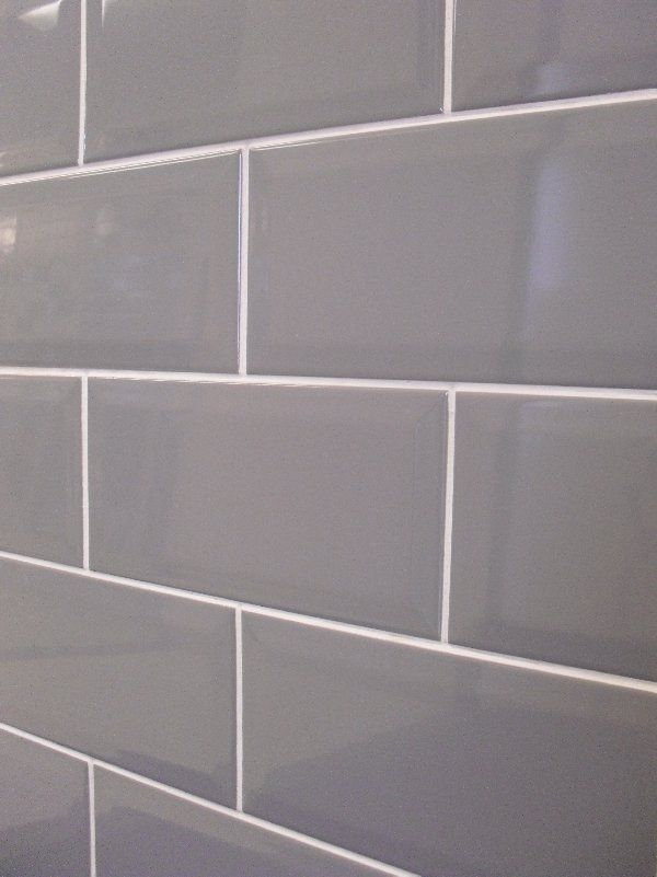 grey subway tile with white grout for behind stainless