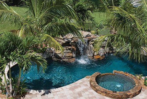 Swimming Pool With Natural Stone Spa And Waterfalls In Fl Pool Waterfall Amazing Swimming Pools Pool Landscaping