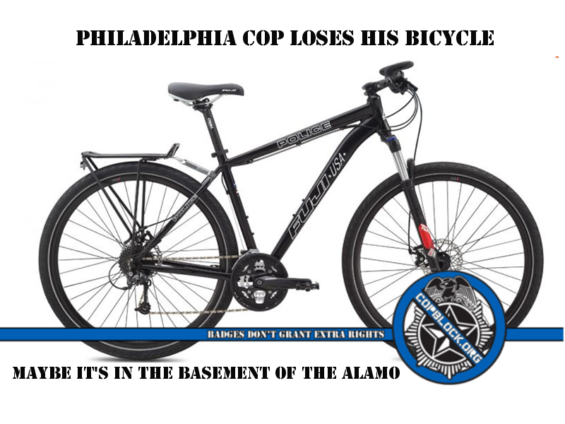 ce7f0b7ca A Philadelphia police officer parked his police bicycle to go into a  convenience store. While