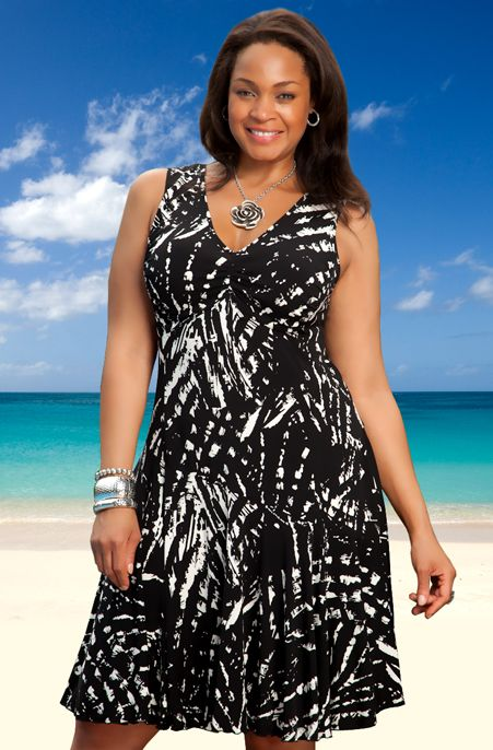 This Always For Me plus size cover up dress will be sure to turn heads. Feel sexy and very comfortable in this Black and White plus size cover up dress with its unique bias cut that creates a flowing f