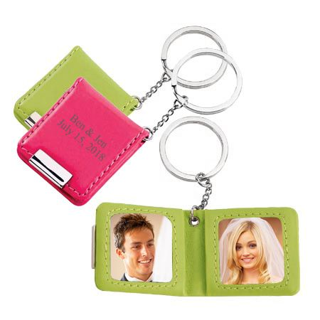 "Double Photo Keychain Size (opened): 3.75""L x 1.6""W With these colorful and snazzy leatherette key chains, your keys will always be sure to stand out in the most fabulous and meaningful way! Each key holder holds 2 small photos when opened, and is the perfect keepsake for anything from wedding photos, to mother and child photos, to just photos of an amazing day spent with that special someone. Available in lime green or hot pink, and you can personalize it with the couple's name or a short…"