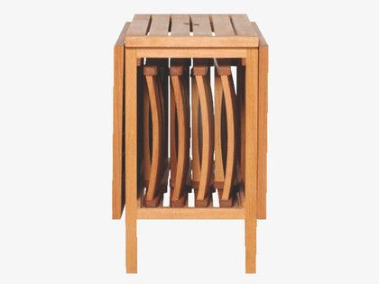 Expandable gateleg table with folding chairs stored inside ...