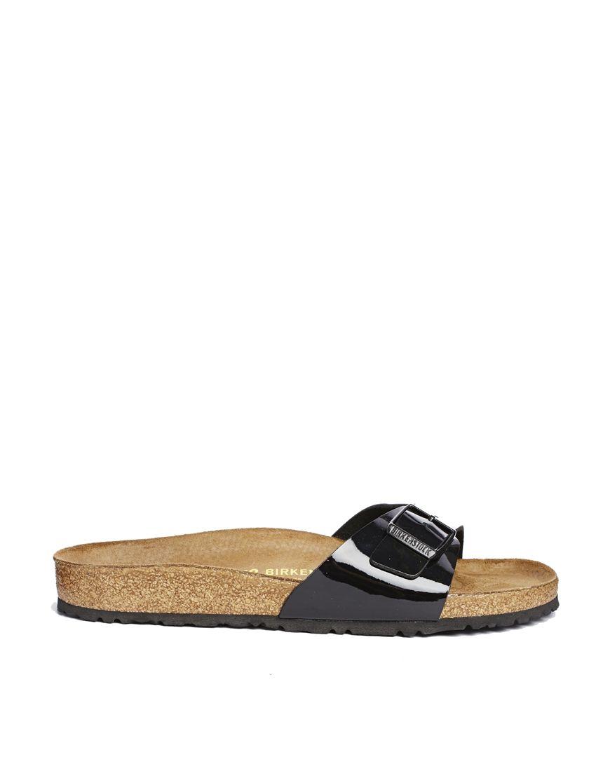 65391d9a28596d Shop Birkenstock Madrid Black Patent Flat Sandals at ASOS.