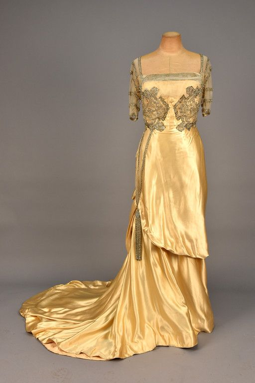 LOT 654 WORTH PARIS TRAINED SATIN EVENING DRESS with PASTE JEWELS, 1910-1912. - whitakerauction