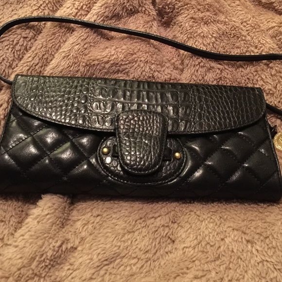 """Brahmin Black Quilted Leather Clutch Authentic Brahmin black quilted leather clutch bag with removable strap. Inside has a mirror attached with credit card slots and plenty of compartments for storage. In excellent preowned condition. Measures approx 10"""" x 5"""" perfect for an evening out or everyday use. Brahmin Bags Clutches & Wristlets"""
