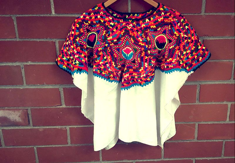 This recycled Mayan blouse is from the village of San Mateo and is handmade with 100% authentic embroidery. This item is woven on a traditional backstrap loom by a female artisan and has also been worn by a Mayan woman in Guatemala. Each blouse is second hand, used, unique and one-of-a-kind. Oversized – Open Sides [...]