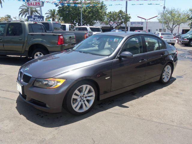 2006 BMW 325, 122,619 miles, $12,995.