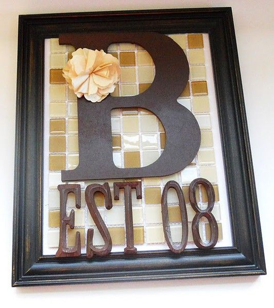 burlap back cut it down to fit within the frame. hot glue panel to a piece of white cardstock. One big initial and small wooden letters from a craft store, spray-painted. Adhere the letters to the tile with hot glue.