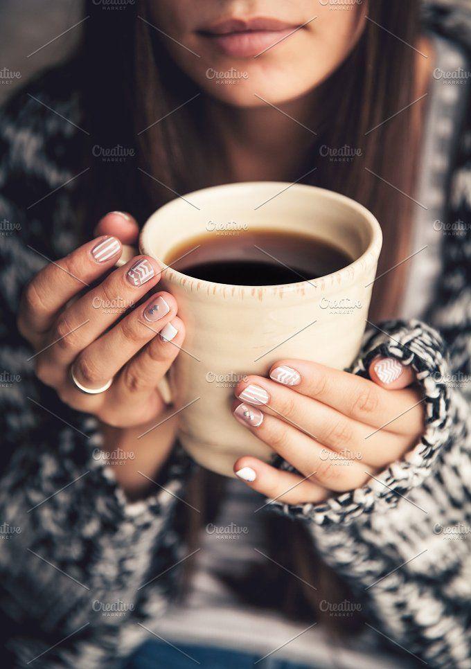 Photo of Coffee and stylish manicure Photos Stylish manicure and a cup of coffee in hand….