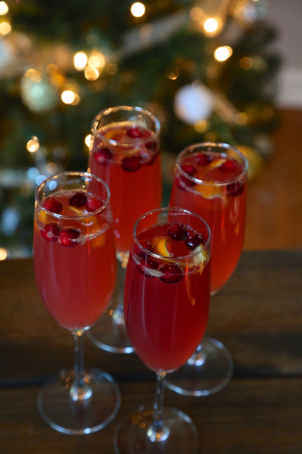 Poinsettia Cocktail With A Splash And A Twist Of Orange Weekend Craft Recipe Poinsettia Cocktail Fruity Cocktails Prosecco Cocktails