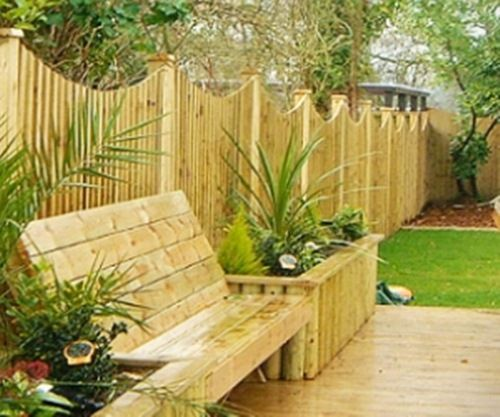 Home garden fencing with bench and raised flower bed for Garden bed fence ideas