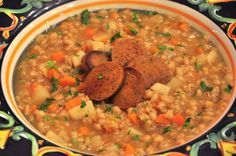 The soup is a riff on Graupensuppe, a German-style barley soup -- carrot, onion, celery root and leeks, topped with fried seitan sausage.