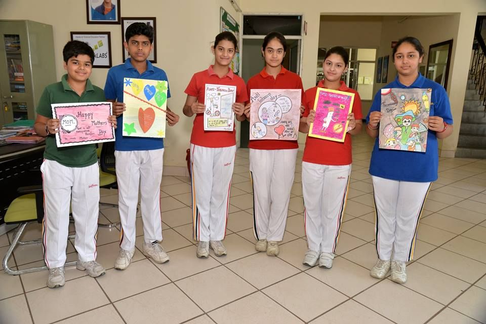 saffron public school organized a poster making competition in the school premises itself the topics