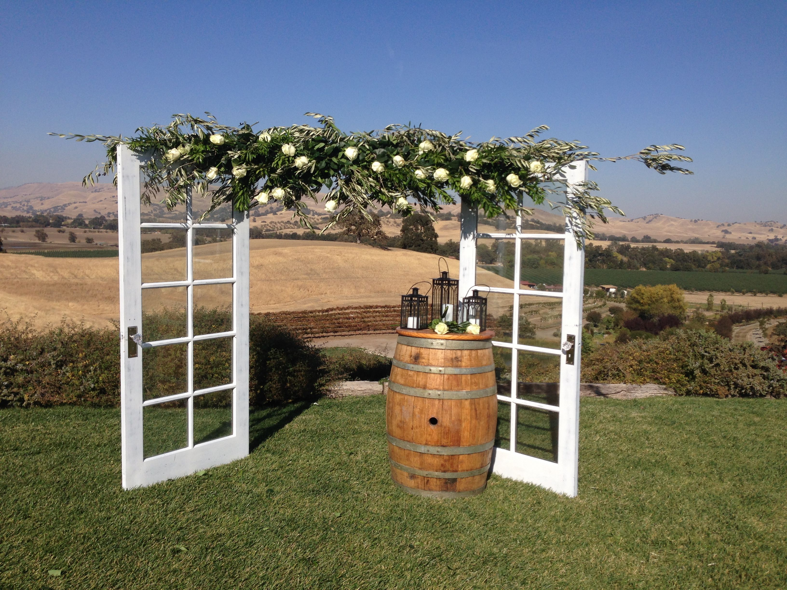 DIY arbor with doors and olive tree branches Couple created for a hilltop wedding at our wedding venue & DIY arbor with doors and olive tree branches Couple created for a ...