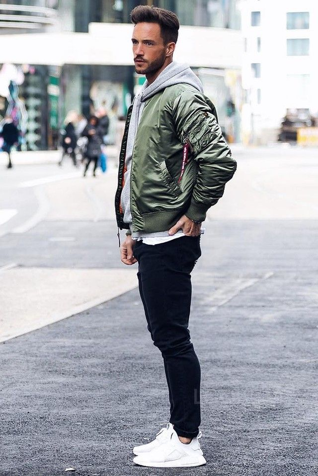 Daniel Fox Waits on street on Mens college fashion