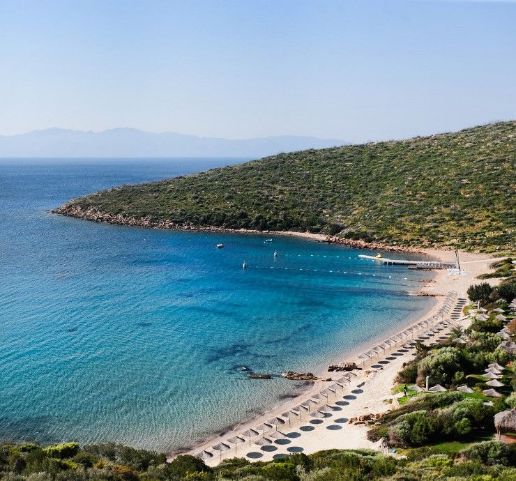 Relax and soak up some rays on this idyllic beach at Kempinski in Turkey
