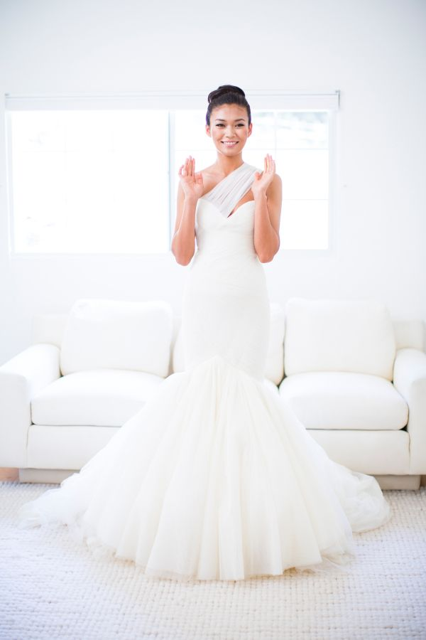 One shoulder chiffon mermaid wedding dress: http://www.stylemepretty.com/2015/11/30/50-elegant-gowns-that-will-never-ever-go-out-of-style/