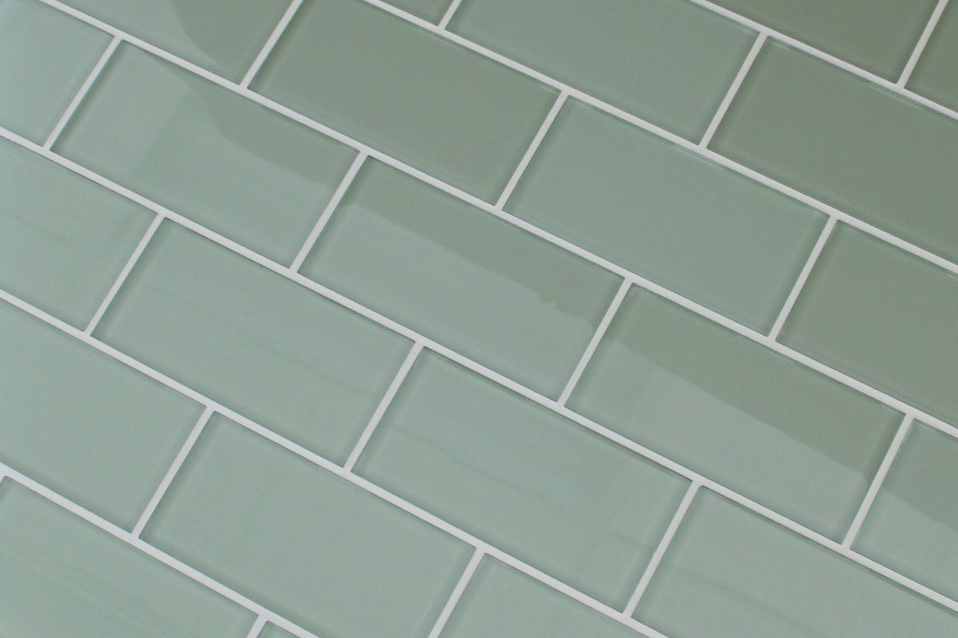excellent dimensions of subway tile. A light sage green glass subway tile  very mellow that will look great in your kitchen Sage Green x Glass Subway Tiles 3x6