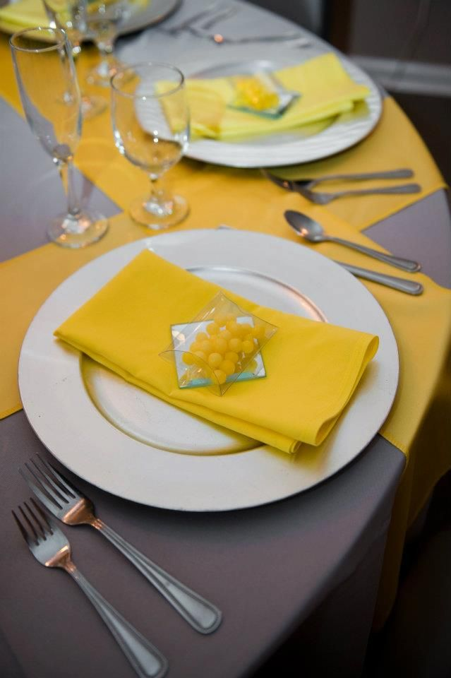 Grey Table Linen accented with Yellow Table Runners and Napkins