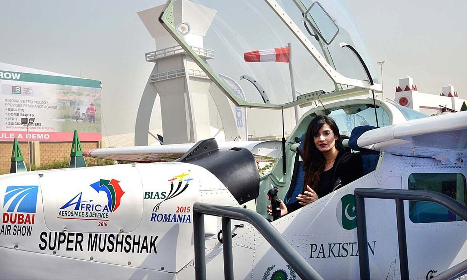 A woman sitting in the cockpit of Super Mushshak aircraft