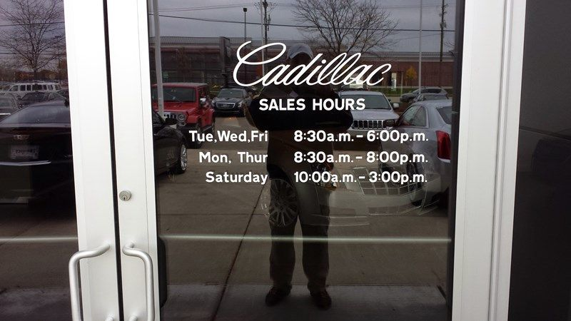 Cadillac store hours decals can be installed on inside or outside doors or windows decals shown are on an outside door in the color white