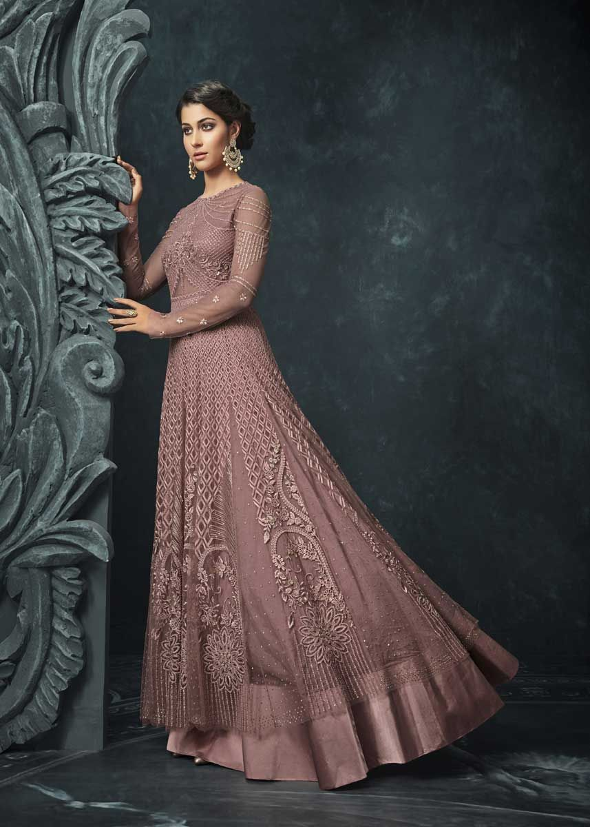 1b300d4acd Let your little one showcase a blend of tradition and style with this  wonderful light wine color net fabric heavy embroidered wedding wear  anarkali suit.