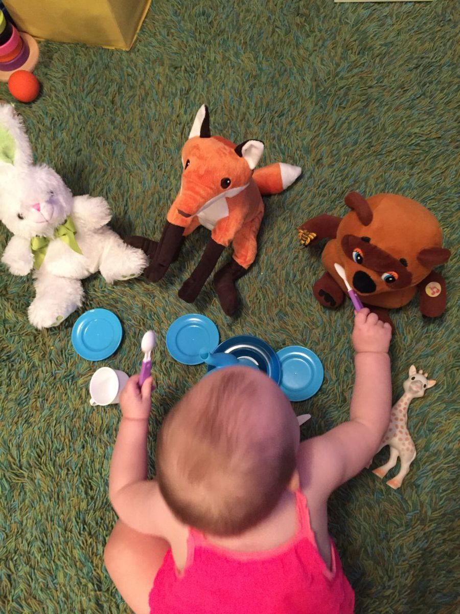 Pretend play, feeding animals, activities for one year old